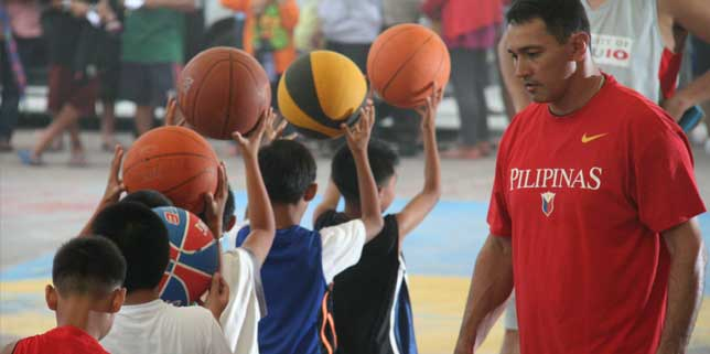 Padcal boys learn from, play ball with PBA legends
